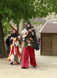 Troubadours on stilts Stock Image