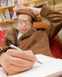 Trouble. Young man writing he's thought but he's got trouble Stock Image
