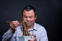 Trouble with chopsticks Royalty Free Stock Photography