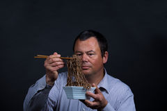 Trouble with chopsticks Royalty Free Stock Photos