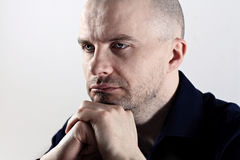 In trouble. Close up of caucasian man looking upset Stock Photo