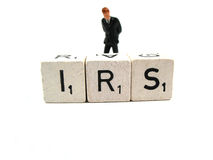 Trouble with the IRS. A man having trouble with the IRS royalty free stock images