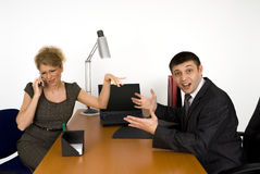 Trouble in office!. Business woman and businessman in office Royalty Free Stock Images