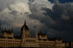 Trouble over Hungary. Dark clouds above the Hungarian Parliament Stock Photography