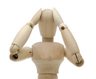 Trouble. Pictured a doll which holds its head Royalty Free Stock Image