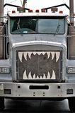 Trouble in the Rearview. Big truck with teeth stock photos