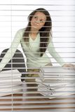 Trouble woman in the office. View through the blind Stock Photography