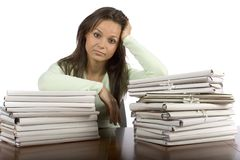 Trouble woman in the office. With heap of files Stock Photography