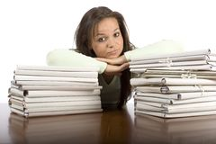 Trouble woman in the office. With heap of files Royalty Free Stock Photography
