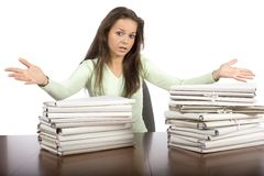 Trouble woman in the office. With heap of files Stock Photo