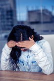 Troubled Asian woman with hands on face Royalty Free Stock Photos