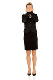 Troubled business woman covering her face with hands Royalty Free Stock Photography