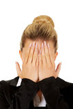 Troubled business woman covering her face with hands Royalty Free Stock Photos