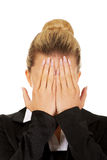 Troubled business woman covering her face with hands Stock Photo
