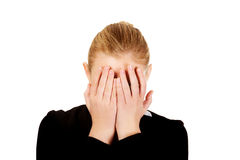 Troubled business woman covering her face with hands.  Stock Photography
