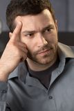 Troubled businessman. Closeup portrait of troubled businessman thinking, looking aside royalty free stock photos