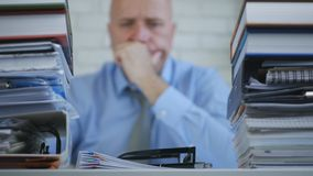 Troubled Businessman Image in Archive Room Thinking Sad and Disappointed. Troubled Businessperson Image in Archive Room Thinking Sad and Disappointed stock image