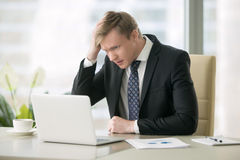 Troubled businessman with laptop Royalty Free Stock Photo