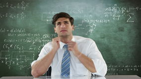 Troubled businessman looking up. Against formulas stock video footage
