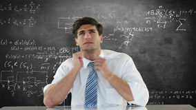 Troubled businessman looking up. Against formulas stock video