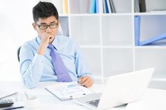 Troubled ceo. Image of a young sales manager worrying about risky strategic movement Royalty Free Stock Photo