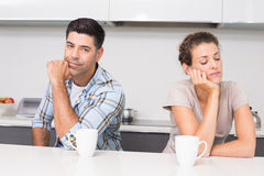 Troubled couple having coffee not talking to each other Stock Images