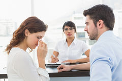 Troubled couple talking with their therapist. In the office Stock Photo
