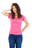 Troubled cute brunette posing Royalty Free Stock Photos