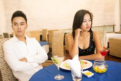Troubled date. Lovers being unhappy because of a troubled date stock images