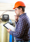 Troubled engineer in hard hat at factory Stock Photography