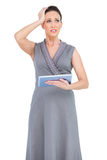 Troubled gorgeous woman holding digital tablet Stock Photo