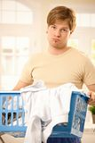 Troubled guy at housework Stock Photo