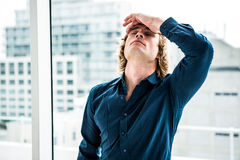 Troubled hipster businessman holding his head Royalty Free Stock Image