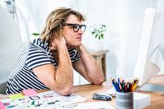 Troubled hipster businessman sitting in his office Royalty Free Stock Photography