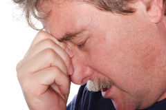 Troubled Man. A man holds his head in anguish Royalty Free Stock Image