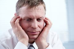 Troubled man. Close-up of a businessman�s pensive face stock photo