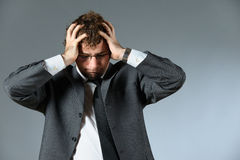 Troubled man. Portrait of stressed young businessman Royalty Free Stock Image