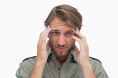 Troubled man with hands on head. On white background royalty free stock photos