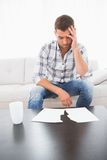 A troubled man looking papers Stock Photography
