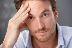 Troubled man portrait. Closeup portrait of troubled man looking at camera, worried royalty free stock images