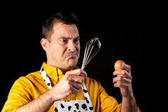 Troubled men. How to whisk an egg, a major challenge Royalty Free Stock Image
