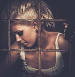Troubled  punk teenager. Troubled teenager girl behind bars Stock Photography