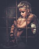 Troubled punk teenager. Troubled teenager girl behind bars stock images