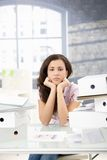 Troubled secretary sitting among folders Stock Images