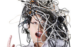 Troubled businesswoman with cables on head. Troubled shocked businesswoman with cables on head Stock Image