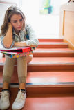 Troubled student sitting on stairs Royalty Free Stock Photography