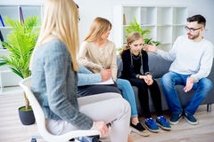 Troubled teen girl. On therapy session with her family and psychiatrist Stock Photos