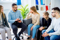 Troubled teen girl. On therapy session with her family and psychiatrist royalty free stock image