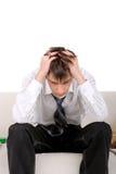 Troubled teenager. Sad teenager sitting on the sofa Stock Image