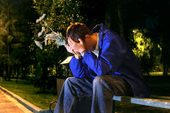 Troubled teenager. Very sad teenager with a flowers in the night park get break an appointmant Royalty Free Stock Images